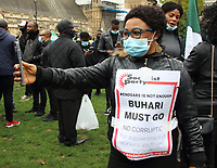 London-Based Nigerians protest against the brutality of the Special Anti-Robbery Squad (SARS) of the Nigerian Police. Amnesty International confirmed it had evidence of excessive use of force resulting in some deaths of protesters at Lekki toll gate last Tuesday. President Buhari dissolved SARS on 11 October, but these protestors still called for his resignation. Parliament Square, London on Saturday October 24th 2020<br /> <br /> Photo by Keith Mayhew