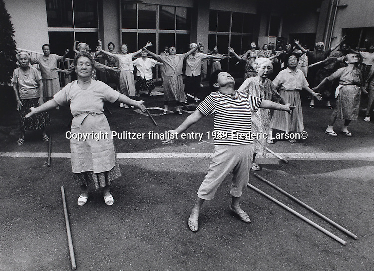 At a nursing home for bomb survivors in Nagasaki Japan residents enjoy an early morning workout in the mountain air..Pulitzer finalist entry 1989 Frederic Larson©