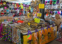 French Quarter, New Orleans, Louisiana.  Alligator Heads, Necklaces, Masks, Paraphernalia for Sale in the French Market.