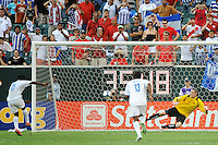 Walter Martinez (15) of Honduras (HON) scores on a penalty kick as Canada (CAN) goalkeeper Greg Sutton (1) dives the wrong way during a quarterfinal match of the CONCACAF Gold Cup at Lincoln Financial Field in Philadelphia, PA, on July 18, 2009.