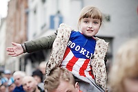 young fans cheer for the riders in the streets of start town Bruges<br /> <br /> 100th Ronde van Vlaanderen 2016