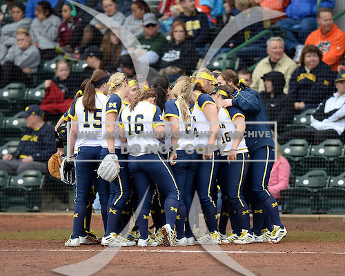 Michigan Wolverines team meeting in between innings during the season opener against the Florida Gators on February 8, 2014 at the USF Softball Stadium in Tampa, Florida.  Florida defeated Michigan 9-4 in extra innings.  (Copyright Mike Janes Photography)