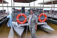 Botswana, Kasane, Chobe National Park, Chobe Game Lodge. All women guides at their safari river boats on the Chobe River. Neo Moatshe.