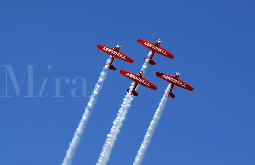 The planes of the Aeroshell demonstration team leave trails of white smoke at the Dayton Airshow
