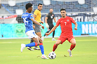 KANSAS CITY, KS - JULY 15: Dutherson Clervaux #15 of Haiti ,Stephen Eustaquio #7 of Canada during a game between Canada and Haiti at Children's Mercy Park on July 15, 2021 in Kansas City, Kansas.