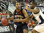 Bucknell's Cameron Ayers looks around Nevada defender Deonte Burton during a second round NIT college basketball game in Reno, Nev. , on Sunday, March 18, 2012. Nevada won 75-67..Photo by Cathleen Allison