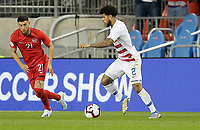 TORONTO, ON - OCTOBER 15: DeAndre Yedlin #2 of the United States moves with the ball during a game between Canada and USMNT at BMO Field on October 15, 2019 in Toronto, Canada.