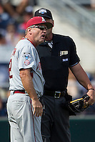 Arkansas Razorbacks head coach Dave Van Horn (2) argues with the umpire ACTION during the NCAA College baseball World Series against the Miami Hurricanes on June 15, 2015 at TD Ameritrade Park in Omaha, Nebraska. Miami beat Arkansas 4-3. (Andrew Woolley/Four Seam Images)