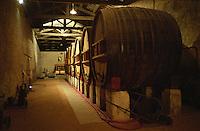 Old wooden fermentation vats (foudres) in the winery at Domaine Saint Martin de la Garrigue, Montagnac, Coteaux du Languedoc, Languedoc-Roussillon, France Grain grainy.