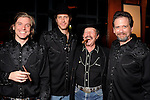 """From left: Adam Van Wagoner, Justin Doran, Kinky Friedman and Tom Prior at a reception held after a reading of """"Becoming Kinky: The World According to Kinky Friedman"""" at the Stages Repertory Theater Friday Aug. 13,2010.(Dave Rossman/For the Chronicle)"""