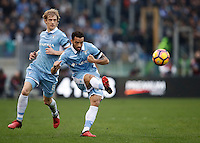 Calcio, Serie A: Lazio vs Roma. Roma, stadio Olimpico, 4 dicembre 2016.<br /> Lazio's Felipe Anderson, right, kicks the ball past his teammate Dusan Basta during the Italian Serie A football match between Lazio and Rome at Rome's Olympic stadium, 4 December 2016. Roma won 2-0.<br /> UPDATE IMAGES PRESS/Isabella Bonotto