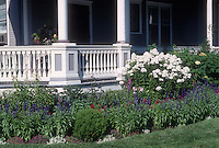 Front porch with foundation planting perennials flowers, salvia farinacea, fragrant garden phlox
