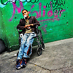 A young drug addict, having his nasal mucous membranes already destroyed, inhales a color solvent through his mouth using a toilet paper, while sitting on a wheel chair in the street of Mexico City, Mexico, 27 October 2016.