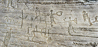 Petroglyph, rock carving, of a group of warriors carrying swords and shileds. Carved by the ancient Camuni people in the iron age between 1000-1600 BC. Rock no 24,  Foppi di Nadro, Riserva Naturale Incisioni Rupestri di Ceto, Cimbergo e Paspardo, Capo di Ponti, Valcamonica (Val Camonica), Lombardy plain, Italy