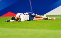 LE HAVRE, FRANCE - APRIL 13: Christen Press #23 of the USWNT lies on the field after being fouled during a game between France and USWNT at Stade Oceane on April 13, 2021 in Le Havre, France.