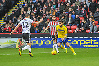 Sheffield United's defender John Egan (12) tries to cut off Leeds United's midfielder Mateusz Klich (43) during the Sky Bet Championship match between Sheff United and Leeds United at Bramall Lane, Sheffield, England on 1 December 2018. Photo by Stephen Buckley / PRiME Media Images.