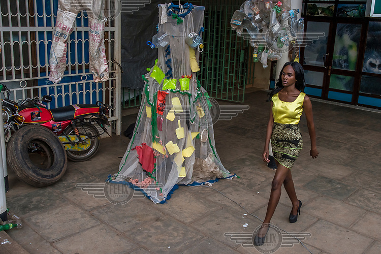 At the Kampala National Theatre, a model parades during a fashion show of creations made by the Afrika Arts Kollective collective, whose niche is waste recovery, with the aim of raising public awareness of the concept of recycling and reuse.