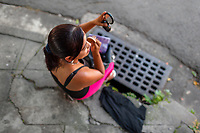 A Salvadoran sex worker applies makeup before beginning a work shift on the street in San Salvador, El Salvador, 19 November 2016. Although prostitution is not legal in El Salvador, dozens of street sex workers, wearing provocative miniskirts, hang out in the dirty streets close to the capital's historic center. Sex workers of all ages are seen on the streets but a significant part of them are single mothers abandoned by their male partners. Due to the absence of state social programs, they often seek solutions to their economic problems in sex work. The environment of street sex business is strongly competitive and dangerous, closely tied to the criminal networks (street gangs) that demand extortion payments. Therefore, sex workers employ any tool at their disposal to struggle hard, either with their fellow workers, with violent clients or with gang members who operate in the harsh world of street prostitution.
