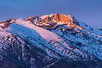 Winter alpenglow sets in on Lone peak in the Wasatch range of Utah
