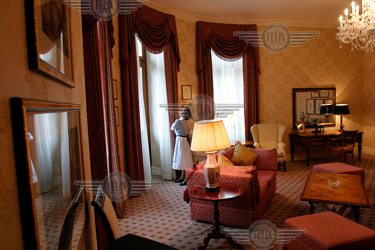 Iwona Kucharska cleaning the appartment at the luxurious Bristol Hotel which was used by US President John F. Kennedy on his visit to Poland.