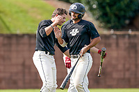 Jason Matthews (11) of the USC Upstate Spartans Black team is greeted after hitting a home run in the Green and Black Fall World Series Game 3 on Sunday, November 1, 2020, at Cleveland S. Harley Park in Spartanburg, South Carolina. (Tom Priddy/Four Seam Images)