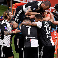 Adrien Rabiot of Juventus celebrates with team mates Federico Bernardeschi, Leonardo Bonucci, Cristiano Ronaldo and Danilo after scoring the goal of 0-1 during the Serie A football match between AC Milan and Juventus FC at stadio San Siro in Milan ( Italy ), July 7th, 2020. Play resumes behind closed doors following the outbreak of the coronavirus disease. <br /> Photo Federico Tardito / Insidefoto