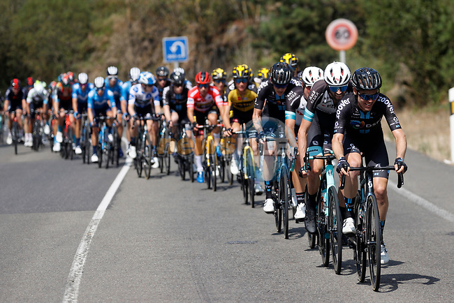 The peloton led by DSM Team and Team BikeExchange during Stage 19 of La Vuelta d'Espana 2021, running 191.2km from Tapia de Casariego to Monforte de Lemos, Spain. 3rd September 2021.    <br /> Picture: Luis Angel Gomez/Photogomezsport | Cyclefile<br /> <br /> All photos usage must carry mandatory copyright credit (© Cyclefile | Luis Angel Gomez/Photogomezsport)