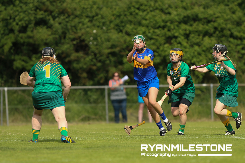 Tipperary's Cait Devane in action against Claire Coffey and Louise Donoghue of Meath during the Liberty Insurance All Ireland Senior Camogie Championship Round 1 between Tipperary and Meath at the Ragg, Co Tipperary. Photo By Michael P Ryan.