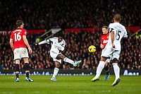 Saturday 11 January 2014 Pictured: Wilfried Bony takes a shot at goal <br /> Re: Barclays Premier League Manchester Utd v Swansea City FC  at Old Trafford, Manchester