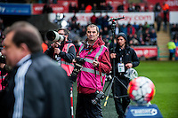 Club Photographer Dimitris Legekis looks bemused for some reason prior to the Barclays Premier League match between Swansea City and Liverpool played at the Liberty Stadium, Swansea  on May the 1st  2016