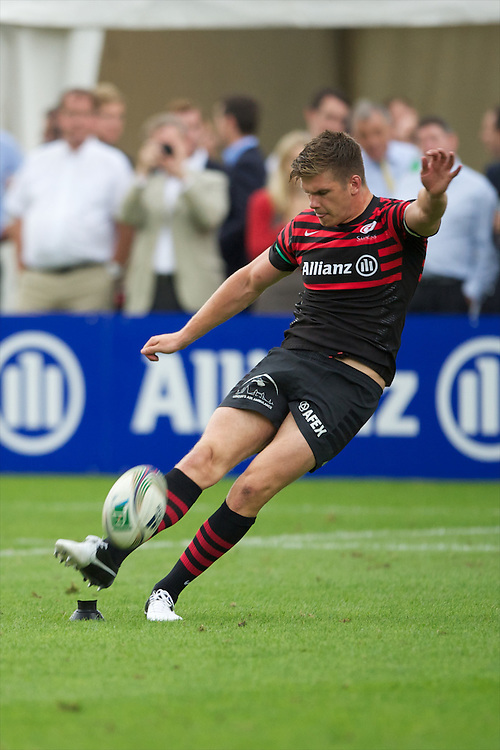 20120823 Copyright onEdition 2012©.Free for editorial use image, please credit: onEdition..Owen Farrell of Saracens takes a penalty kick at The Honourable Artillery Company, London in the pre-season friendly between Saracens and Stade Francais Paris...For press contacts contact: Sam Feasey at brandRapport on M: +44 (0)7717 757114 E: SFeasey@brand-rapport.com..If you require a higher resolution image or you have any other onEdition photographic enquiries, please contact onEdition on 0845 900 2 900 or email info@onEdition.com.This image is copyright the onEdition 2012©..This image has been supplied by onEdition and must be credited onEdition. The author is asserting his full Moral rights in relation to the publication of this image. Rights for onward transmission of any image or file is not granted or implied. Changing or deleting Copyright information is illegal as specified in the Copyright, Design and Patents Act 1988. If you are in any way unsure of your right to publish this image please contact onEdition on 0845 900 2 900 or email info@onEdition.com