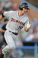Delmarva Shorebirds third baseman Drew Dosch #10 runs to first during opening night game against the Asheville Tourists at McCormick Field on April 3, 2014 in Asheville, North Carolina. The Tourists defeated the Shorebirds 8-3. (Tony Farlow/Four Seam Images)