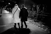 Switzerland. Canton Ticino. Lugano. Two elderly women walk at night during a cold evening. 5.01.2020  © 2020 Didier Ruef