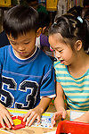 Public elementary school  Grade 1 math activity boy and girl working with manipulatives