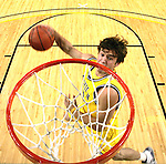 "Michigan guard Zack Novak competes in a slam-dunk contest during the college basketball team's ""Michigan Madness"" festivities at Crisler Arena, Friday, Oct. 16, 2009, in Ann Arbor, Mich. (AP Photo/Tony Ding)"