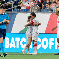 FOXBOROUGH, MA - JULY 7: Tsubasa Endoh #31 of Toronto FC celebrates his goal with teammate during a game between Toronto FC and New England Revolution at Gillette Stadium on July 7, 2021 in Foxborough, Massachusetts.
