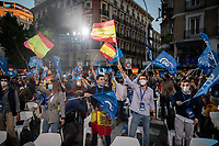 MADRID, SPAIN – MAY 04: A group of people waves the Spanish flags and PP flags in front of the PP headquarters as a sign of victory on 4 May in Madrid, Spain. (Photo by Joan Amengual / VIEWpress via Getty Images)