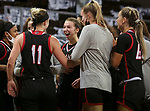 SIOUX FALLS, SD - MARCH 6: Sarah Schmitt #1 of the Omaha Mavericks celebrates with her teammates after knocking off the South Dakota State Jackrabbits 52-40 during the Summit League Basketball Tournament at the Sanford Pentagon in Sioux Falls, SD. (Photo by Dave Eggen/Inertia)
