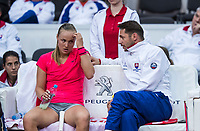 Bratislava, Slovenia, April 22, 2017,  FedCup: Slovakia-Netherlands, seccond rubber : Rebecca Sramkova (SVK) on the bench with captain Matej Liptak<br /> Photo: Tennisimages/Henk Koster