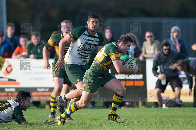 Joe Reynolds makes a telling break through the midfield for Pukekohe. Counties Manukau Premier Club Rugby game between Pukekohe and Manurewa, played at Colin Lawrie Fields, Pukekohe, on Saturday May 28th, 2016. Pukekohe won the game 62 - 18 after leading 19 - 10 at halftime. Photo by Richard Spranger.
