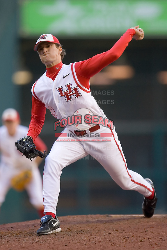 Relief pitcher Jimmy Raviele #8 of the Houston Cougars in action versus the UC-Irvine Anteaters in the 2009 Houston College Classic at Minute Maid Park February 28, 2009 in Houston, TX.  The Anteaters defeated the Cougars 13-7. (Photo by Brian Westerholt / Four Seam Images)