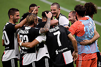 Cristiano Ronaldo of Juventus celebrates with team mates after scoring the goal of 0-2 during the Serie A football match between AC Milan and Juventus FC at stadio San Siro in Milan ( Italy ), July 7th, 2020. Play resumes behind closed doors following the outbreak of the coronavirus disease. <br /> Photo Federico Tardito / Insidefoto