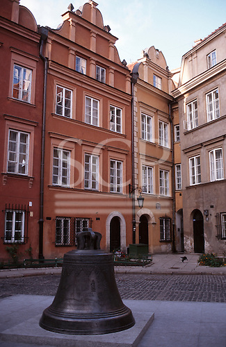 Warsaw, Poland. Cracked cathedral bell with typical buildings from the Old Town. The bell was cast in 1646 by Daniel Tym. Kanonia Square.