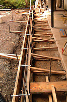 Forms are set to pour a concrete foundation in a residential construction project.