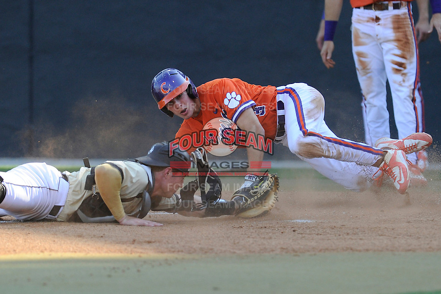Designated hitter Tyler Krieger (3) of the Clemson Tigers is out at home following a tag from catcher Carson Waln of the Wofford College Terriers on Tuesday, May 5, 2015, at Russell C. King Field in Spartanburg, South Carolina. Wofford won, 17-9. (Tom Priddy/Four Seam Images)