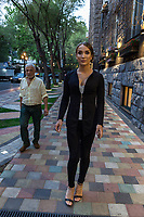 Armenia. Yerevan. Monica Sarkisyan is a transgender woman. She is wearing high heels shoes and walks on a sidewalk. An elderly man looks at her sexy body. A trans woman (sometimes trans-woman or transwoman) is a woman who was assigned male at birth. Trans women may experience gender dysphoria and may transition; this process commonly includes hormone replacement therapy and sometimes sex reassignment surgery, which can bring immense relief and even resolve gender dysphoria entirely. Yerevan, sometimes spelled Erevan, is the capital and largest city of Armenia. 9.10.2019 © 2019 Didier Ruef
