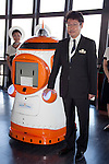 """August 01 2012, Tokyo, Japan - (L to R) The new robot guide """"Tawabo"""" and the president of Tokyo Tower, Shin Maeda show the employee ID in the ceremony. Tokyo Tower implemented the new robot guide which name is """"Tawabo"""", the first indoor robot guide in Japan. It can speak Japanese, English, Chinese and Korean, it weights 200kg and it is 160cm tall."""