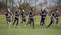 Pictured: Players warm up Thursday 25 February<br />Re: Swansea City FC training at Fairwood, near Swansea, Wales, UK, ahead of their game against Tottenham Hotspur.