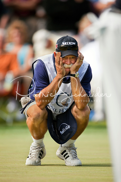 """Mike """"Fluff"""" Cowan, caddie for Jim Furyk, studies the hole during the Quail Hollow Championship golf tournament 2009. The event, formerly called the Wachovia Championship, is a top event on the PGA Tour, attracting such popular golf icons as Tiger Woods, Vijay Singh and Bubba Watson. Photo from the first round in the Quail Hollow Championship golf tournament at the Quail Hollow Club in Charlotte, N.C., Thursday, April 30, 2009."""
