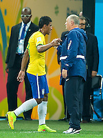 Paulinho of Brazil is substituted off the field by Brazil head coach Luiz Felipe Scolari